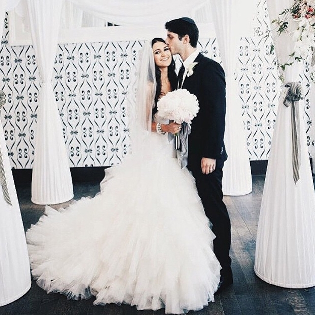 groom standing with bride wearing beautiful Winnie Couture wedding dress