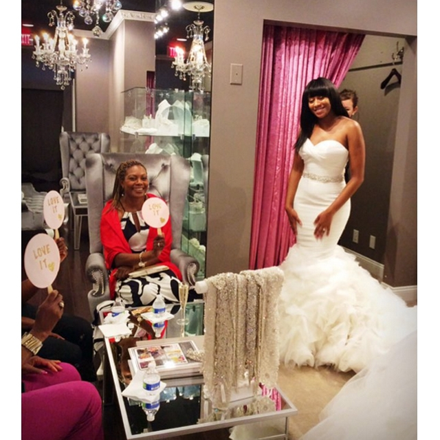Bride to be trying on wedding dress